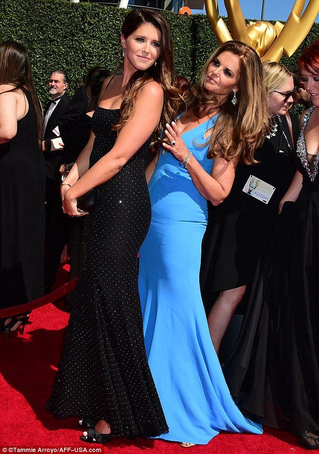Ladies: Maria Shriver and her daughter Katherine Schwarzenegger cuddled up for a snap toge...