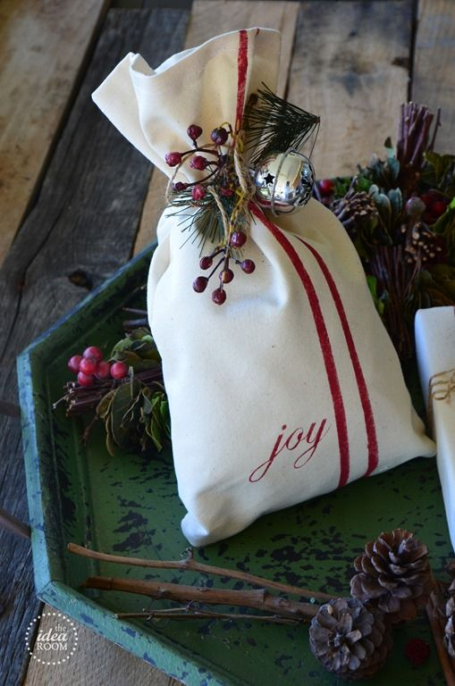 Looking for some fun, unique and creative gift wrap ideas? Learn how to make these simple but adorable gift bags that look like they are made out of vintage grain sacks. Full tutorial and pictures.