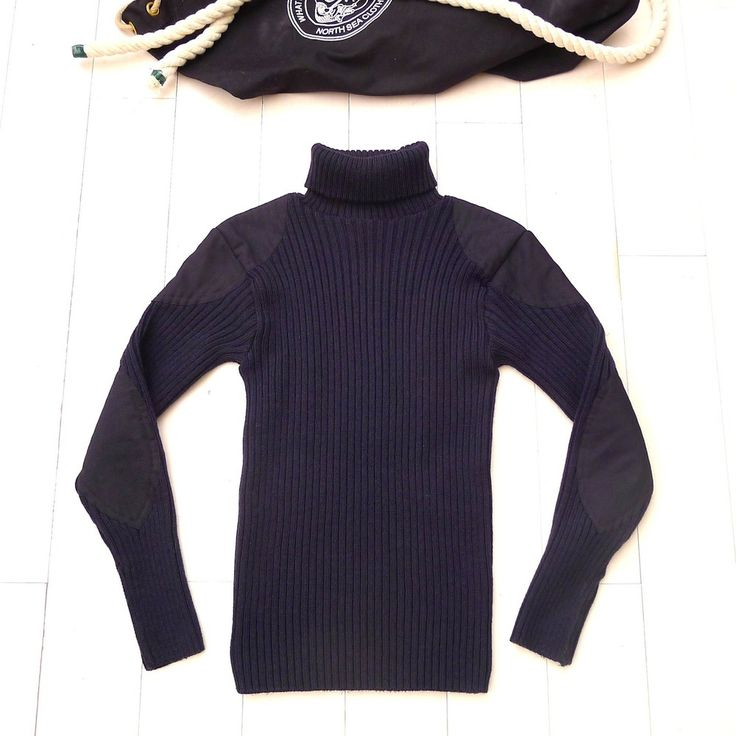 """The  """"Service""""  Made with 100% British wool.Ribbed knit construction with shoulder and elbow patches."""