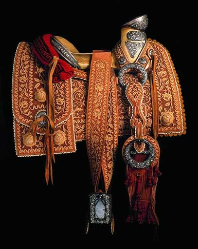 Traditional Mexican saddle from Arte en la Charrería: The Artisanship of Mexican Equestrian Culture exhibit. - #HorseTack