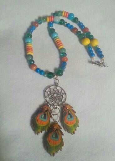 Check out this item in my Etsy shop https://www.etsy.com/uk/listing/290917593/dreamcatcher-colourful-gemstone-necklace