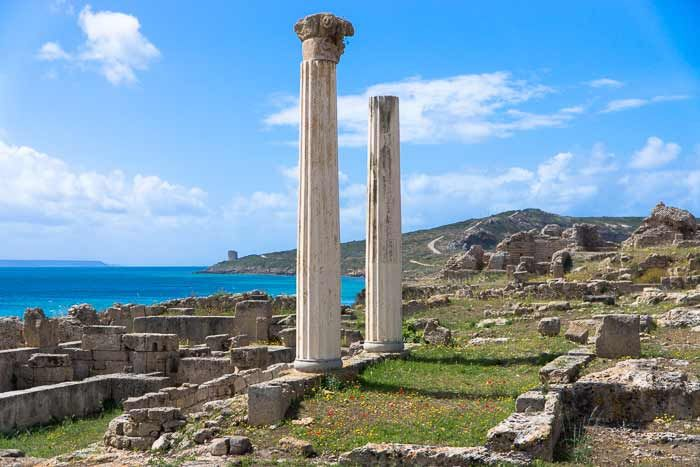 Tharros is an ancient Phoenician-Roman Port on the Sinis Penninsula of Sardinia near Cabras. On a fine spring day the iconic Corinthian columns of Tharros seem to hold up the sky to keep it from falling upon the shimmering waters of the Mediterranean.
