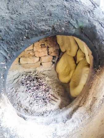 Kyrgyzstan - What to expect foodwise: meat, vegetables and here the bread cooked in traditional oven - click for more photos and information