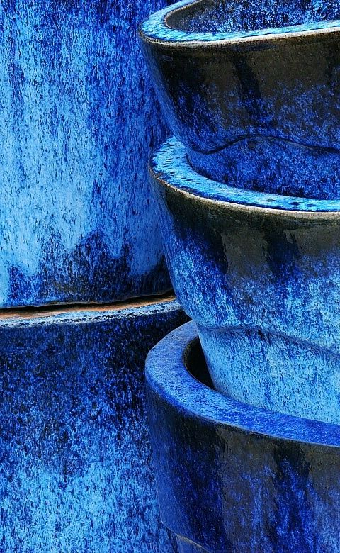 brilliant blue glazed plant pots - imagine yellow flowers spilling out of these!