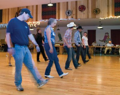 """Texas line dancing.  Anyone who thought that rock 'n roll separated couples never counted on this.  Imagine. . . people """"dancing"""" in separate """"lines.""""  Looks like fun, but I'm too old fashioned to consider it dancing."""