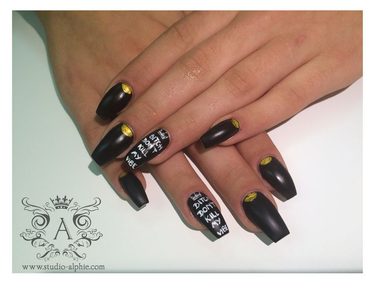 Moto nails, black with gold foil.