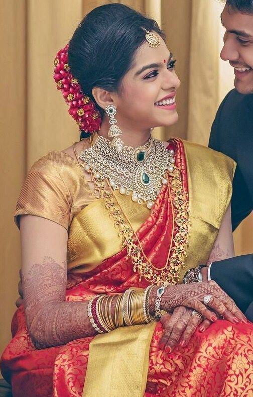 South Indian bride. Indian diamond bridal jewelry. Jhumkis.Red silk kanchipuram sari.Braid with fresh jasmine flowers. Tamil bride. Telugu bride. Kannada bride. Hindu bride. Malayalee bride.Kerala bride.South Indian wedding.