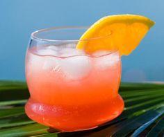 Ricetta del cocktail analcolico Garibaldi. Ingredienti: 7 cl succo d'arancia, 3 cl bitter campari, mezza fetta d'arancia per decorare