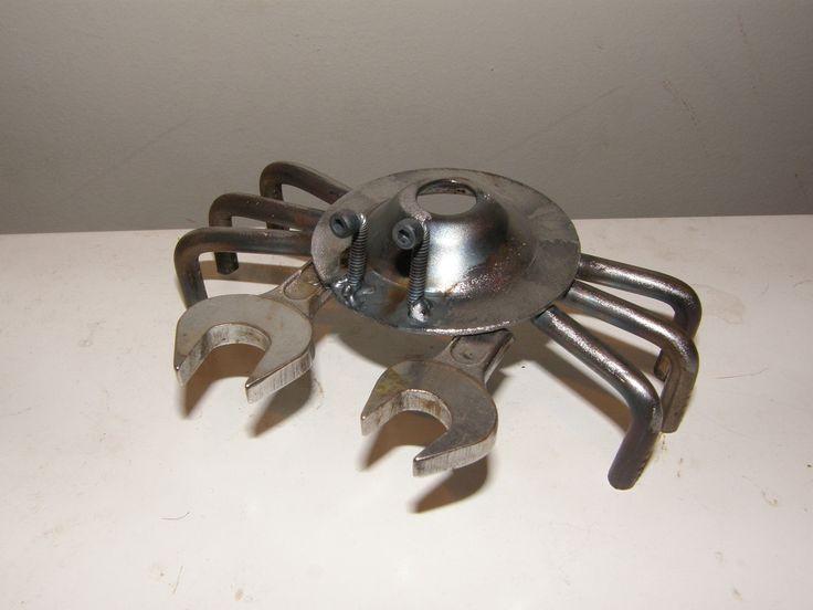 recycled metal garden sculpture. by Metalsworking via Etsy.
