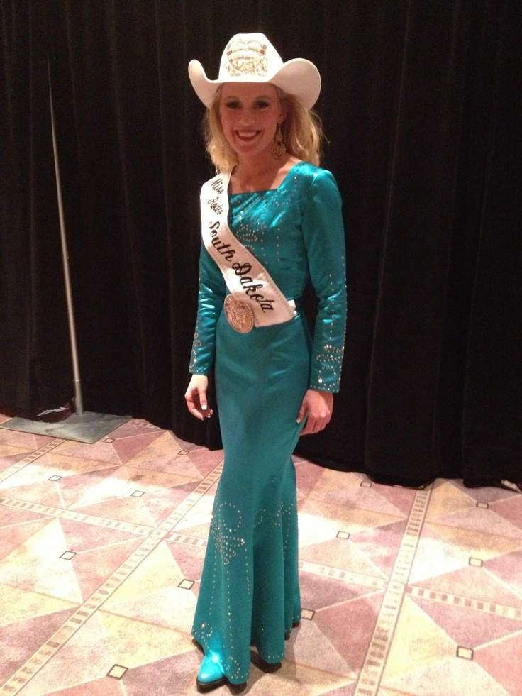 Miss Rodeo South Dakota in her Western Elegance Dress during the Miss Rodeo America Pageant Fashion Show. #WranglerNFR