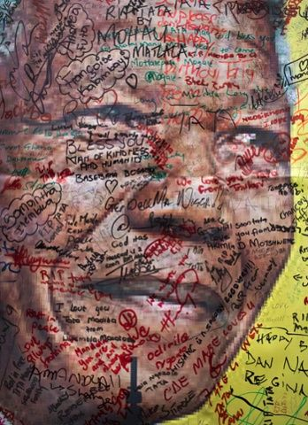 A poster of Mandela on which well-wishers have written their messages of condolence and support in Soweto, Johannesburg.