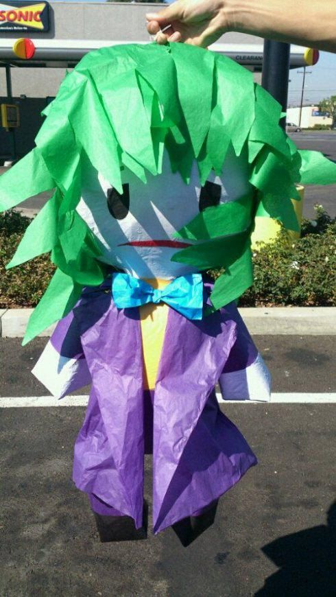 Instead of beating up Batman! Awesome for a superhero party! :)Joker Pinata on Etsy, $44.99