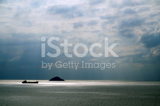 Cloudscape and Sea with Little Ship and Island royalty-free stock photo