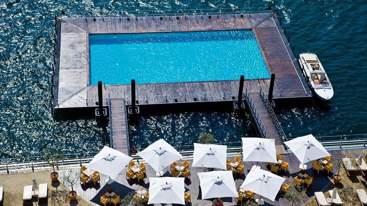 The Grand Hotel Tremezzo pool floats on a lake. At Lake Como, Lombardy, Italy.