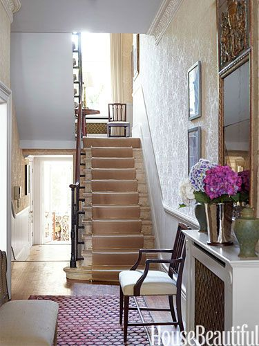 Entry walls are covered in a classic damask pattern printed on raffia paper by Stark. In an 1860 house in South Kensington, England.  CFB