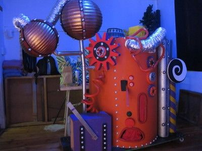 Giant Sweet Machine. Knobs can turn, levers can go up and down and a whole for producing sweets. A great prop for a Willy Wonka party!