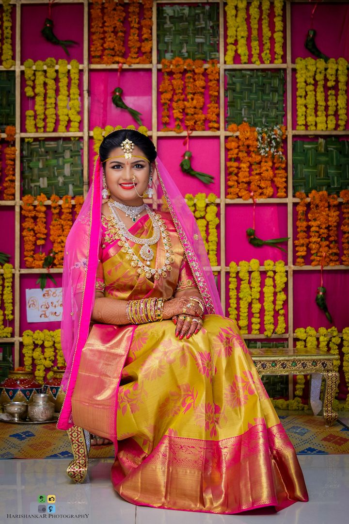 Silk sarees have always been the most awed at and adored by traditional outfits of all times. Even after the advent of Indo-western culture, the excitement South-Indian women get towards draping a silk saree knows no bounds. With such delight and sparkle in our eyes, it's a pleasure for us to feature brides who chose to flaunt traditional silk sarees on their big day. Here are our most favourite picks of bridal sarees this year. Fall in love with them just like how we did a...