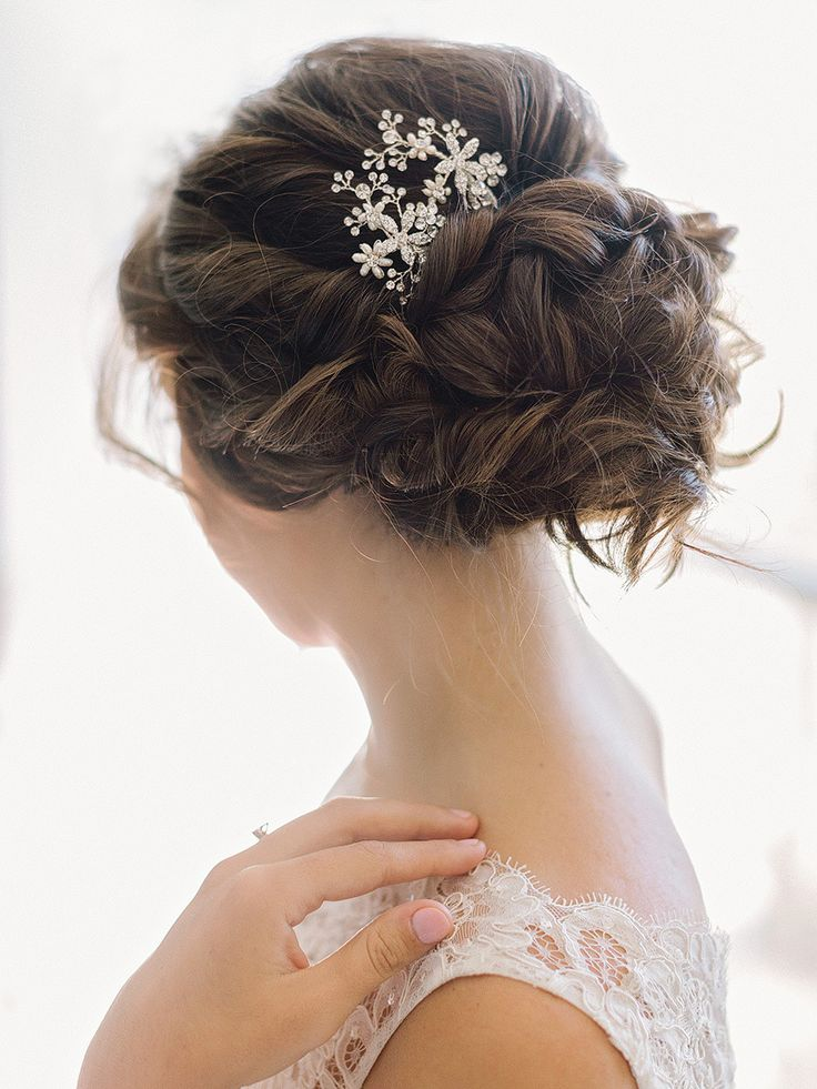 twisted bridal updo with sparkly hair accessory | Photography: Elizabeth Marie Weddings + Events