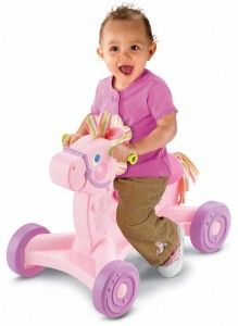 Brilliant Basics Roll-Along Musical Pony This ride-on is cute and functions well.  It is up high off the ground, compared to other ride-on toys.  http://awsomegadgetsandtoysforgirlsandboys.com/fisher-price-toys-12-24-months/ Brilliant Basics Roll-Along Musical Pony