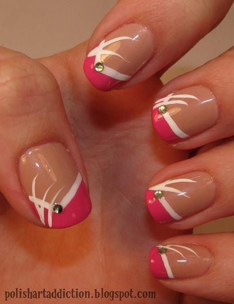 A fun way to update a bright French tip mani. Do your base neutral. Use a brighter shade for making a V French tip (you don't have to worry about making the lines on the French really crisp. Using a med-fine art brush, line the interphase between your bright V tips and base. Add 2 whisps looking like grasses or weeds, tapering the tips of each of the 3 'grass' strokes. Addition of a rhinestone is optional.