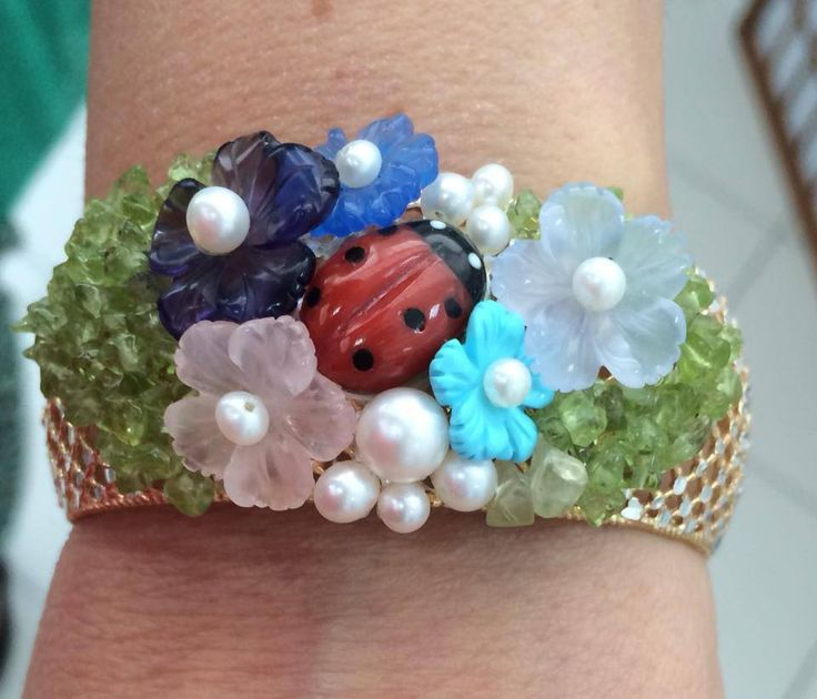 Coral bug, aquamarine, lapis, blue agate, pink quartz, peridot, Akoya pearls and silver 925*** cuff bracelet.