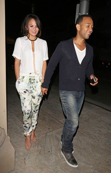 Singer John Legend Leaves Mastros Steakhouse after having dinner with his wife Christy in Beverly Hills.