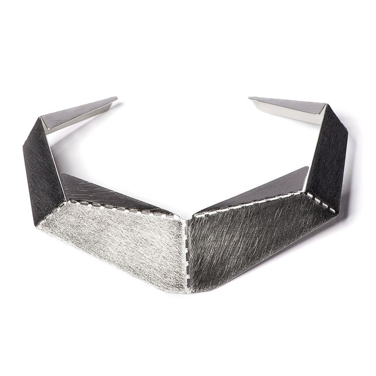 Hand crafted necklace made of matte and partly polished stainless stee.