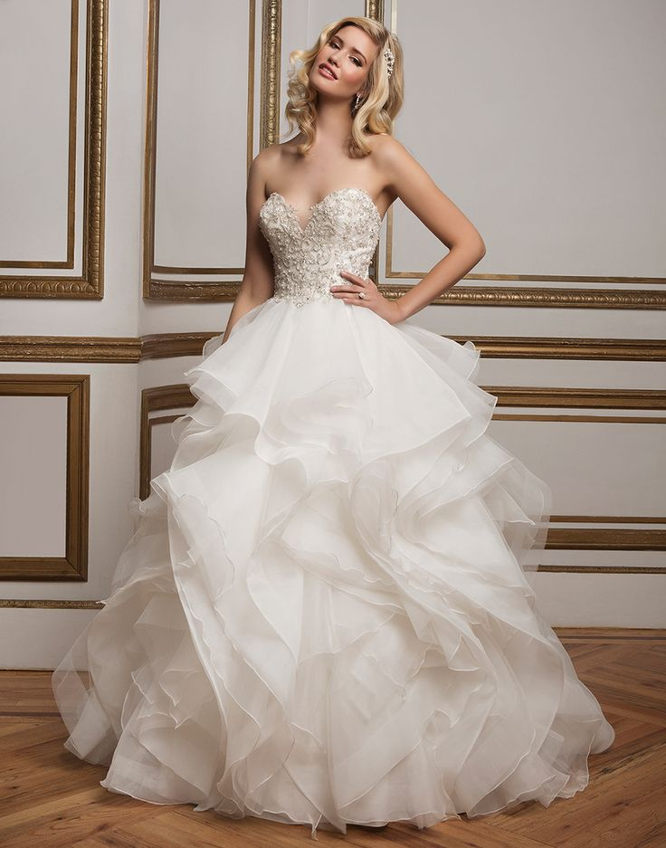 Intricately beaded metallic lace sweetheart bodice, organza ruffle skirt and horsehair tulle layers add an alluring twist to a classic ball gown.