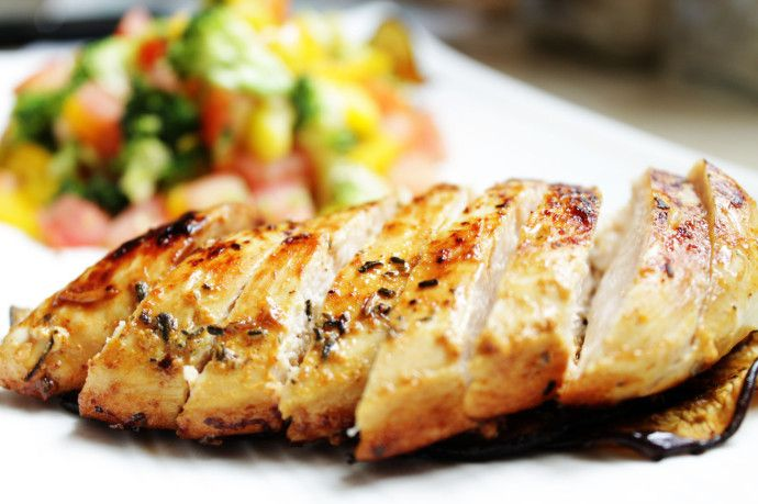 Pan-grilled chicken on roasted egg plants N Fresh salad