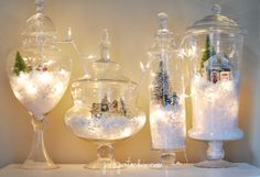 You only need a few simple materials to create these stunning Christmas Light Snow Globe Terrariums!