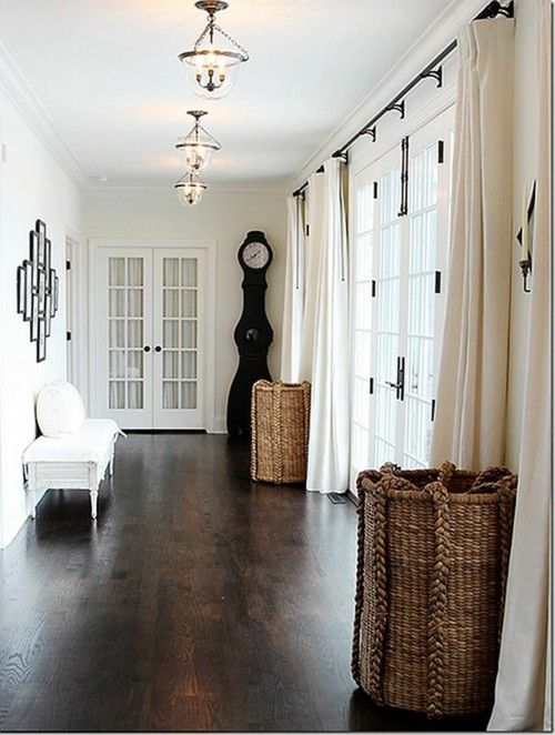 Dark hardwood floors are the most versatile colour - dress it up, dress it down, make it sophisticated or rustic. Anything goes!