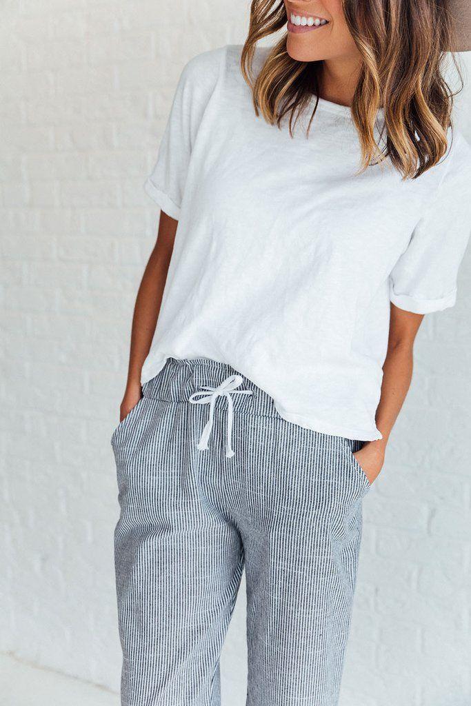 DETAILS: - Ankle-length drawstring pant - Pinstripe print - Lightweight cotton - Model is wearing size S MEASUREMENTS: - Thigh(Cm): S:54cm, M:56cm, L:58cm, XL:60cm - Hip Size(Cm): S:92cm, M:96cm, L:10