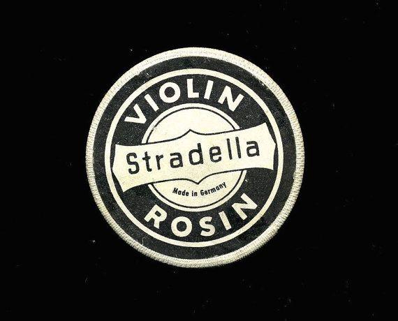 Never-used antique violin rosin in stylish original tube case. Cover label reads, Stradella Violin Rosin - MADE IN GERMANY. Rare!    Case and