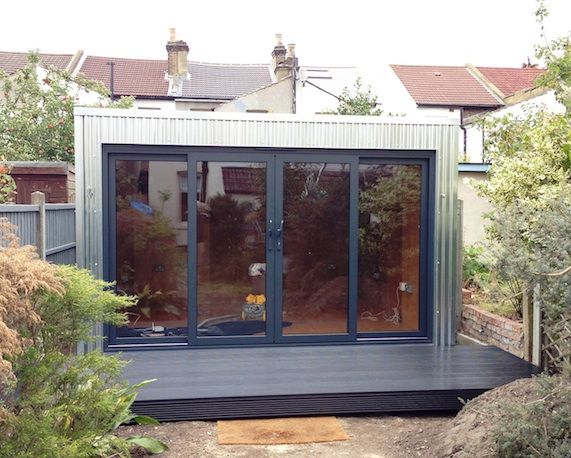 3 recently completed garden buildings an industrial style office with metal cladding a building with a curved wall and a garden pod for freelancer dog building home office