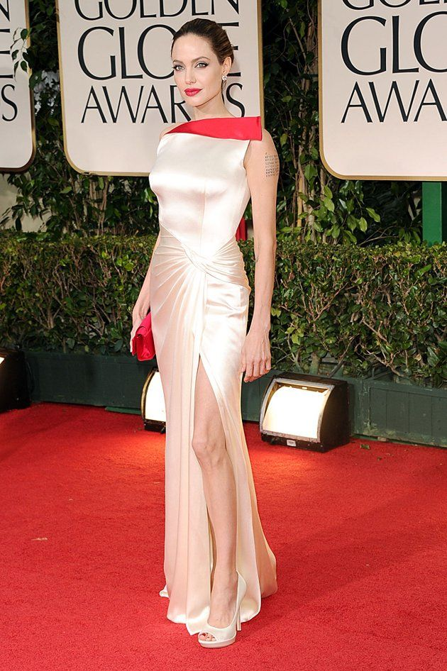 Angelina Jolie Grade: A+ Angelina Jolie had jaws dropping in her dramatic white Atelier Versace gown, which featured a pop of bright red trim.