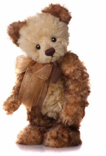 """""""Evie"""" created by Charlie Bears. Bright eyes, thick curly fur, in a lovely blend of colours. Finished with a double organza bow in 2 contrasting colours."""