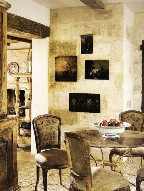 Aged plaster on the wall offsets the art on this lovely for Country wall art for dining room