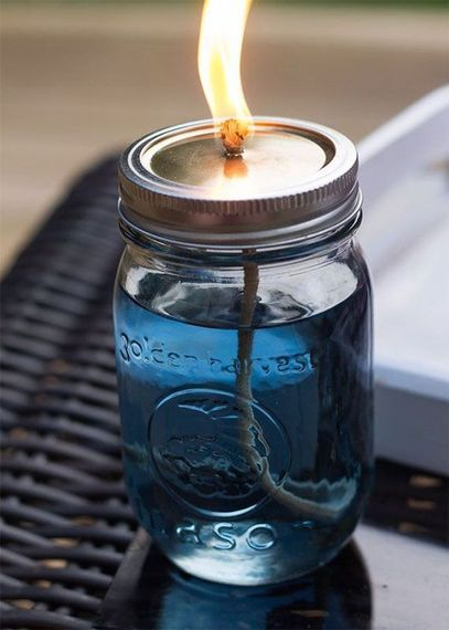 See how to turn your old Mason jars into cute citronella candles!