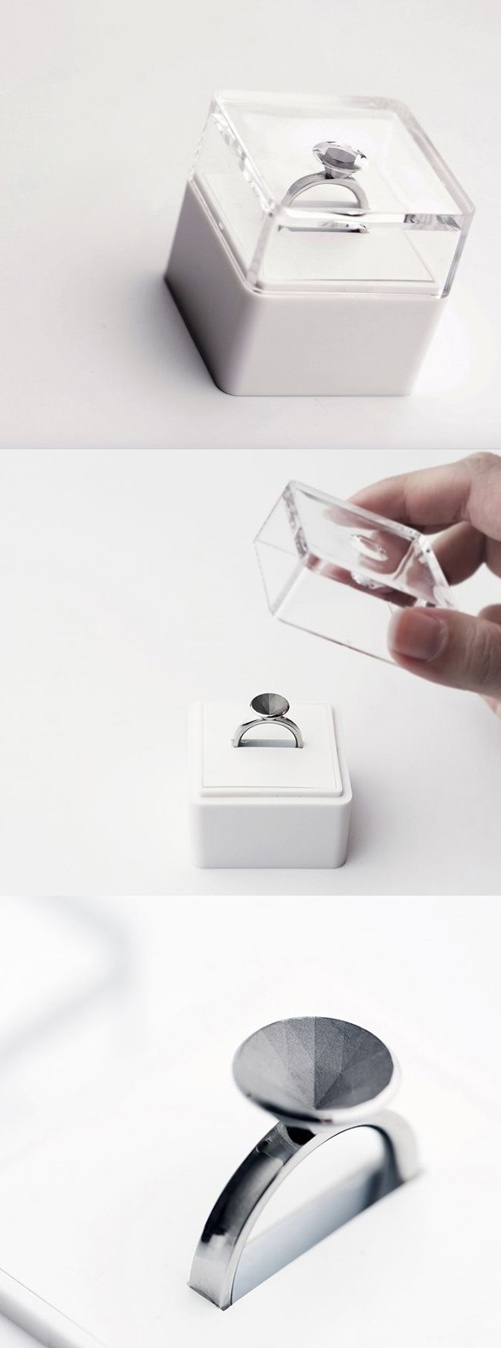 Invisible Love Ring by SashaPure. Upon opening the box, it is revealed that the sparkling facets are, in fact, only on the surface of the package