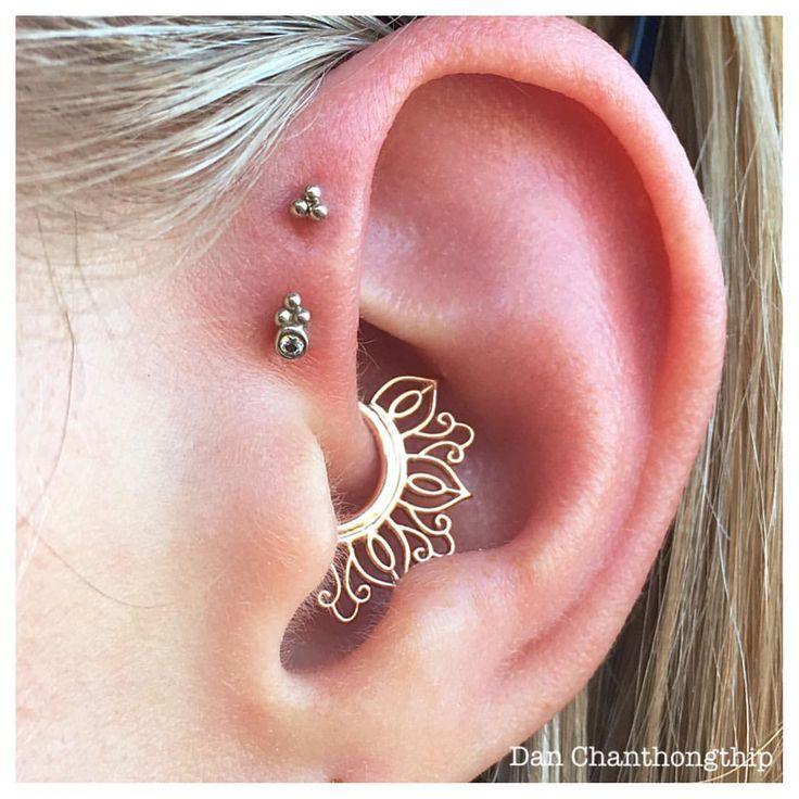 Double forward helix and daith piercing