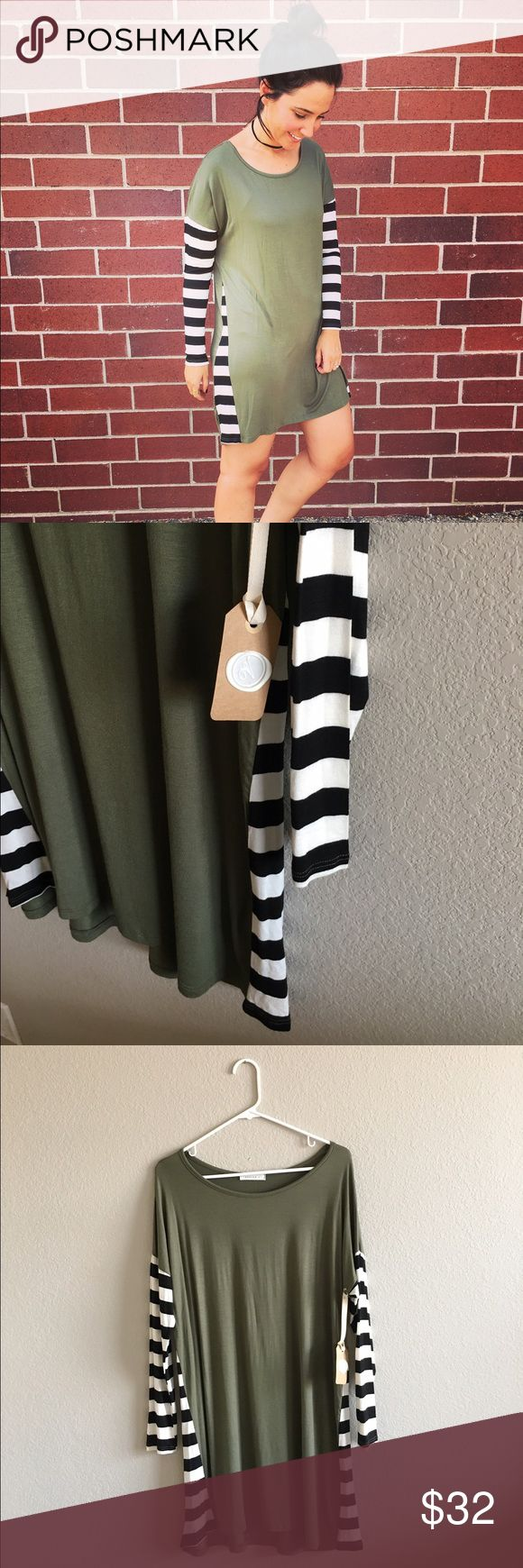 Striped Sleeve Dress - Last One 96% rayon and 4% spandex. Made in the USA. Olive dress with black and white striped sleeves and side stripe detail. 34.5 inches from shoulder top to bottom hem. Dresses