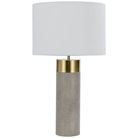 Sleek and sophisticated, this ivory-gray and metallic brass cylinder table lamp has a fresh, contemporary look that will transform any space.