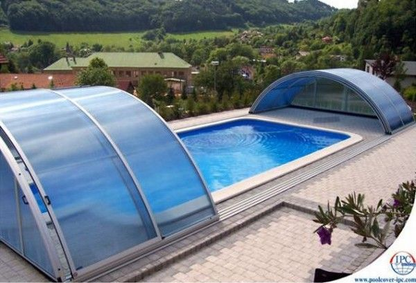 Retractable roof pool --- genius idea for Seattle.  I'd have pool parties every weekend!