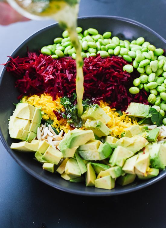 We've discovered heaven-in-a-bowl with this vibrant medley of avocado, quinoa, beets, spinach, and edamame.