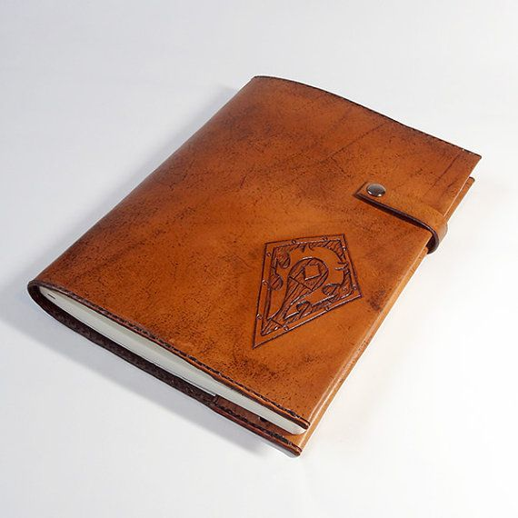 This could make a great guest book/wedding memory book.  Large Horde Hand Tooled Leather Notebook by LudoModernLeather, $98.00