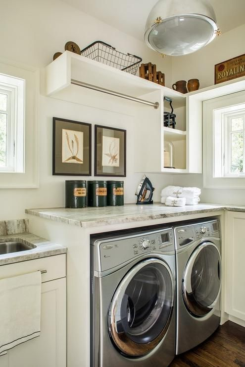 Clic Cottage Laundry Room Features A White And Gray Granite Countertop Positioned Over Silver Front Loading Washer Dryer Enclosed Beside Ivory