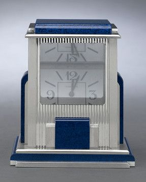 Cartier Prism Mystery Clock. In this Art Deco-style timepiece, the hidden dial can only be seen at a certain angle. c1960