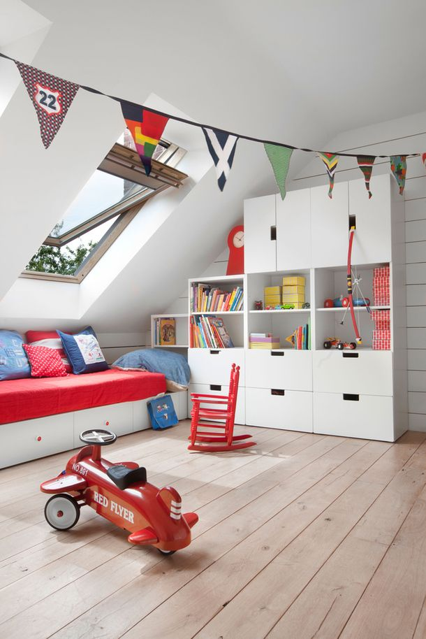 Hardwood flooring and removable upholstery makes for a manageable playroom! Also consider ample, low shelving that your kids can reach.