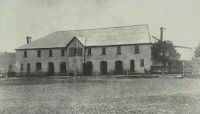 The stables of John Oxley's Kirkham property,in south western Sydney (year unknown).The 1816 Colonial Georgian Kirkham Stables building is one of the oldest stable and farm buildings in Australia.The stables are functionalist and rectangular in form with symmetrical elevations.The stables and the foundations of the original single storey house which was used to make up the foundations of Camelot House are the only parts of the original property.
