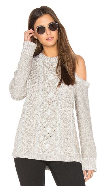 Arlene Sweater by BCBGMAXAZRIA. 40% poly 20% metallic fiber 20% merino wool 20% acrylic. Hand wash cold. Shoulder cut-outs. Cable knit detail. Rib kn...